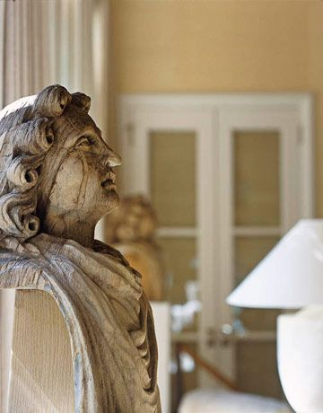Aristocratic Twist in a Texas Living Room; One of a pair of aristocratic wood busts in the living room.
