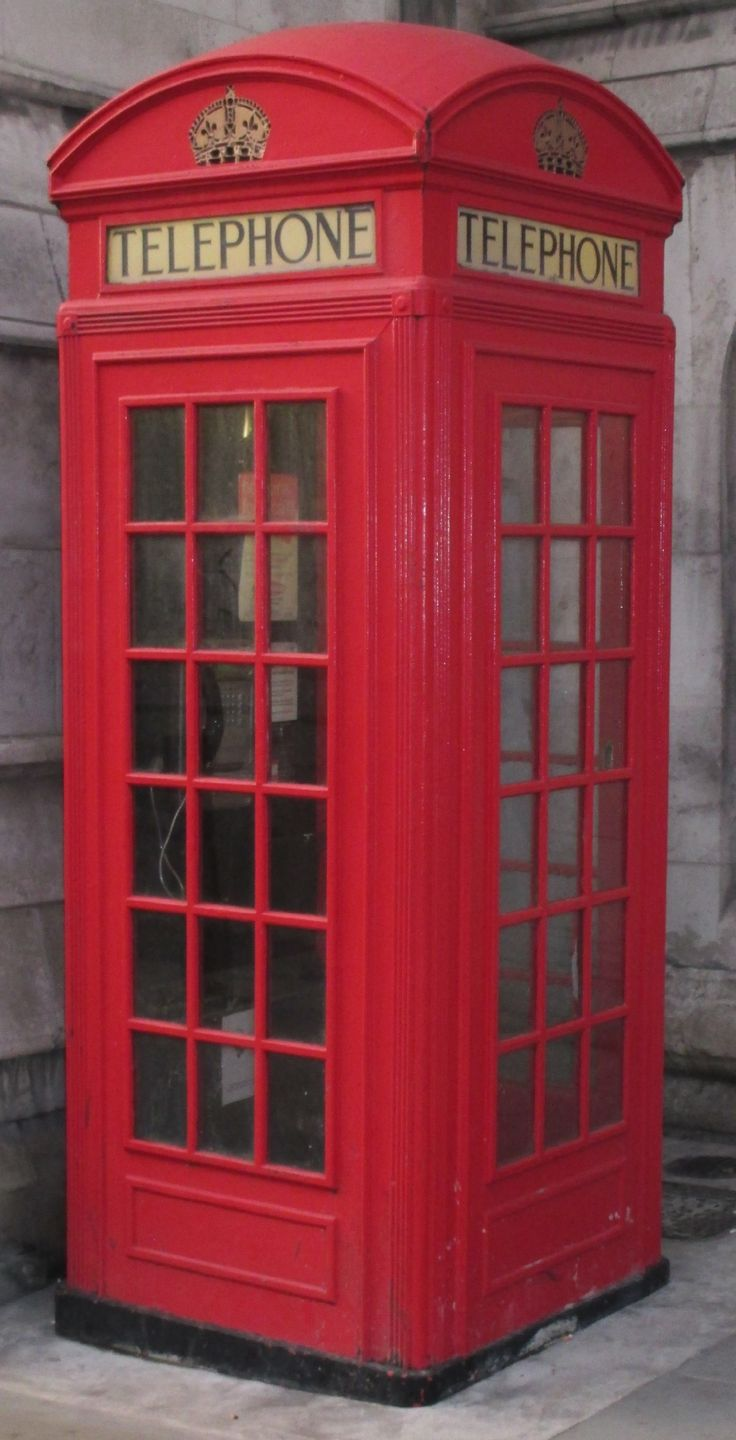 A K2 GPO telephone box designed by Gilbert Scott and first manufactured in 1925. Photographed in Fleet Street in the City of London in December 2016.