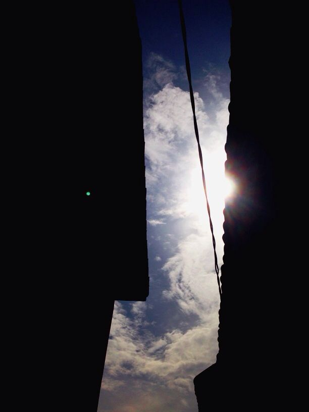 Looking at the sky from an alley