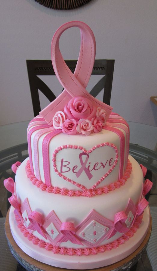 This is a cake i designed for a woman who works with my wife and I. She was very recently diagnosed with breast cancer and we were asked to donate a cake for a fundraiser on her behalf, needless to say we jumped at the opportunity to help out. This cake is all fondant, Ribbon is fondant w/ tylose. The cake generated tons of cash to help keep the family afloat while they begin there fight with this all to common disease. Our hearts and thoughts go out to them, There is hope! Believe!