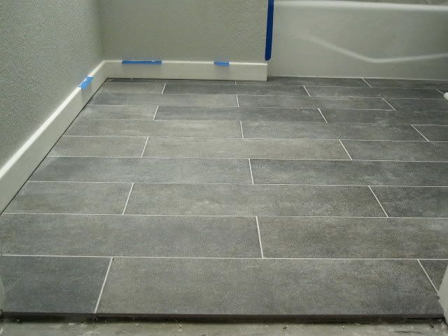 Crossville ceramic co from the great indoors 6 x 24 for Basement bathroom flooring ideas