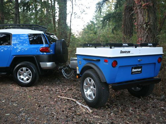 An image of the Toyota FJ Cruiser 25 with matching off-road trailer.
