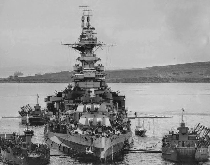 15 in Queen Elizabeth class battleship HMS Malaya at Scapa Flow in 1943, the year she was placed in reserve: she was never modernised to the same extent as sisters 'QE', Valiant and Warspite (neither had Barham, sunk in 1941). In WW1 (1916) she was seriously damaged at Jutland, suffering 65 dead.