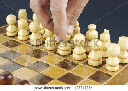 Hand moving a pawn
