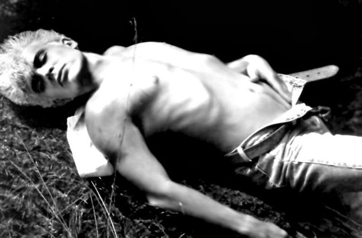 Billy Idol goes shirtless for a provocative black & white picture.