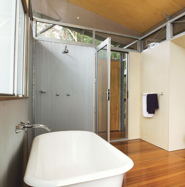 In Australia's Northern Territory, architect Sue Harper conceived a prefab structure comprised of three pavilions joined by suspended walkways. For the master bathroom, she clad the walls in steel. Harper and her husband, Andy Irvine, used BlueScope's Zincalume Mini Orb steel sheeting that has fine corrugations. It is usually employed as external cladding, so it is durable and highly resistant to moisture. Read the whole story here.