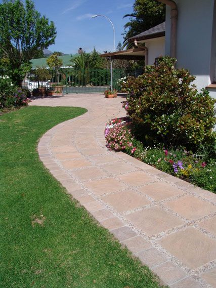 A winding pathway created with products from Stonemarket (Pty) Ltd, Cape Town, South Africa.