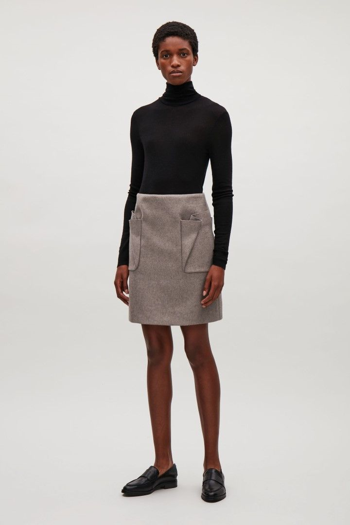 COS image 1 of Short skirt with pleated pockets in Taupe