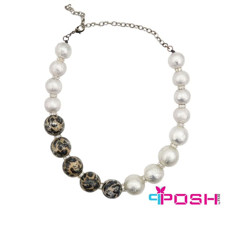 - Safari Collection by POSH - Necklace with iridescent white beading - Crystal clasps in between the beads - Accented in animal print beading  POSH by FERI - Passion for Fashion - Luxury fashion jewelry for the designer in you.