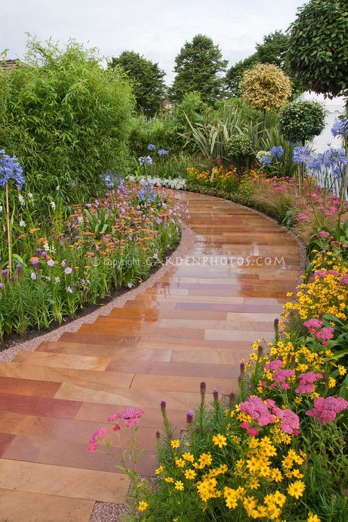 love these pavers and what a great border with agapanthus, coreopsis, achillea and more.  beautiful.