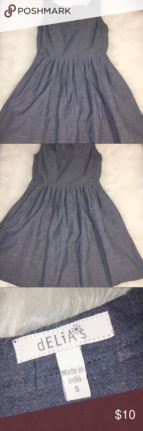 DELIA'S SMALL DENIM STYLE COCKTAIL DRESS DELIA'S SMALL DENIM STYLE COCKTAIL DRESS. PERFECT FOR FALL LAYERING. GREAT CONDITION. SLEEVELESS. ZIPS UP BACK. HIGH WAISTED. NOT ELASTIC. Delia's Dresses