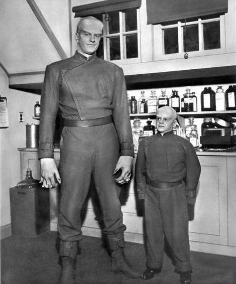 "James Arness and Billy Curtis behind the scenes of The Thing from Another World (1951). Arness stood 6'7"" while Curtis stood 4' 2."" Curtis was actually hired to play a smaller version of the monster near the end of the movie."
