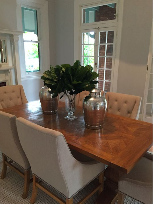 Fiddle leaf in a beautiful crystal vase, amazing silver gingers jars and chairs.  all sourced by Ornella Botter Interiors.