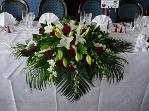 Top Table Waterfall Arrangement Of Kentia Palms And Fatsia Leaves With Oriental Lilies Roses