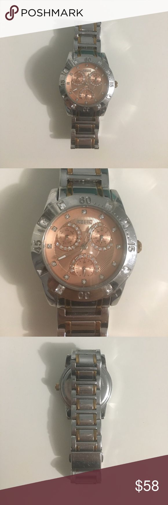 Rose gold Stainless steel RELIC watch Excellent condition, stainless steel, water resistant, works perfectly, no missing stones, not rusted or damaged Relic Jewelry