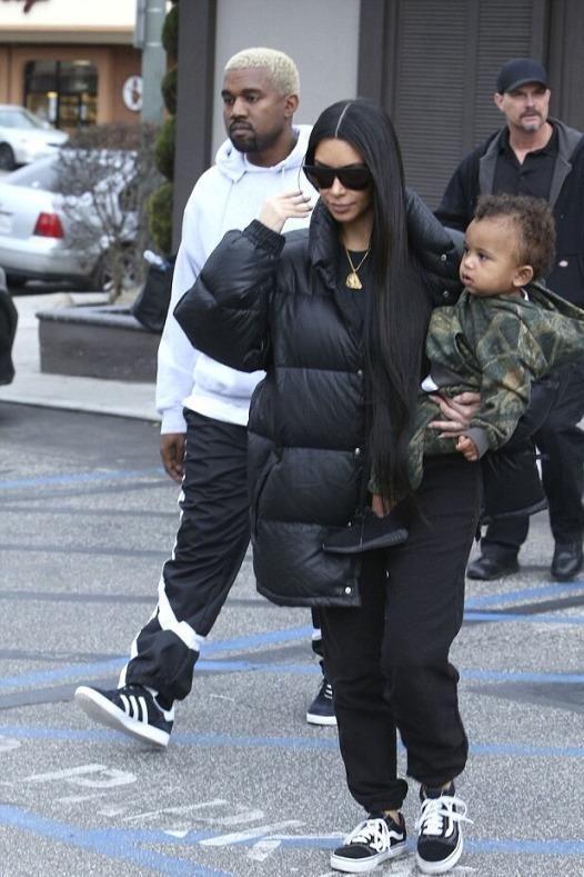 Kim Kardashian wearing Vans Old Skool Sneakers in Black