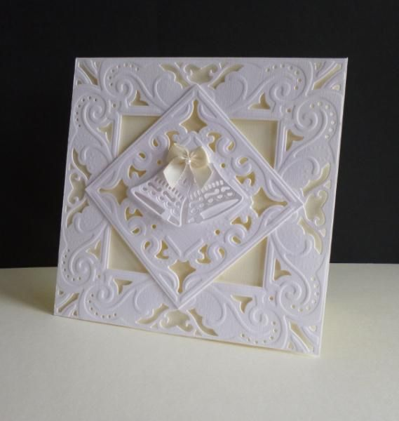 I am loving this large 6 x 6 frame die - hence another wedding card! I popped up the frame on foam pads and cut away the white frame at the corners of the small panel so it's all cream beneath.