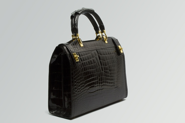 CATERINA       Elegant bag, side locks  and double handle