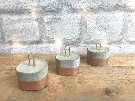 These cute but versatile concrete paperclip holders would look gorgeous at home …