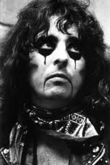 Master of macabre rock theatrics, 70's rockstar Alice Cooper. Push aside the impeccable makeup, the on-stage guillotines, the boa constrictors and elaborate costuming and you'll discover a solid singer in Mr Cooper.