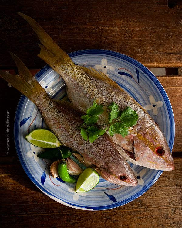 Caribbean Yellowtail Snapper: Cooked with coconut oil, serrano peppers and served with corn tortillas by @SpicieFoodie | #Mexican #snapper #spicy