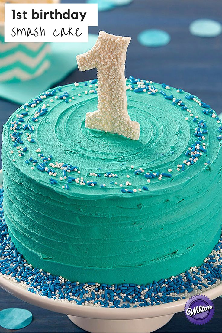 Your little one will love diving into this First Birthday Smash Cake! With a bold teal icing and a cute candy topper, this smash cake is sure to be a hit at the party!