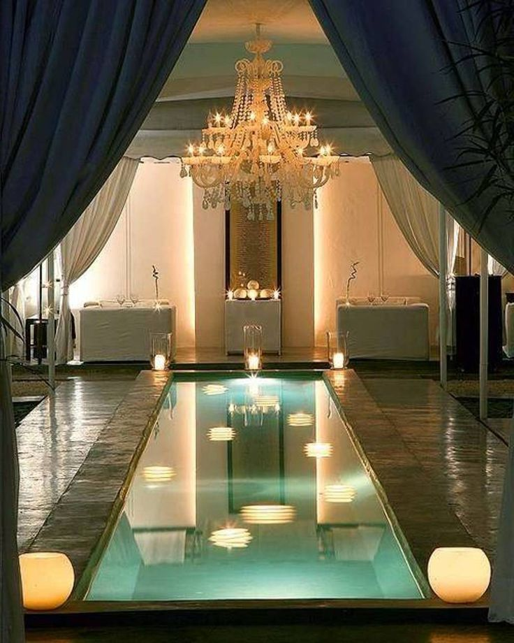 Small indoor swimming pool with chandelier
