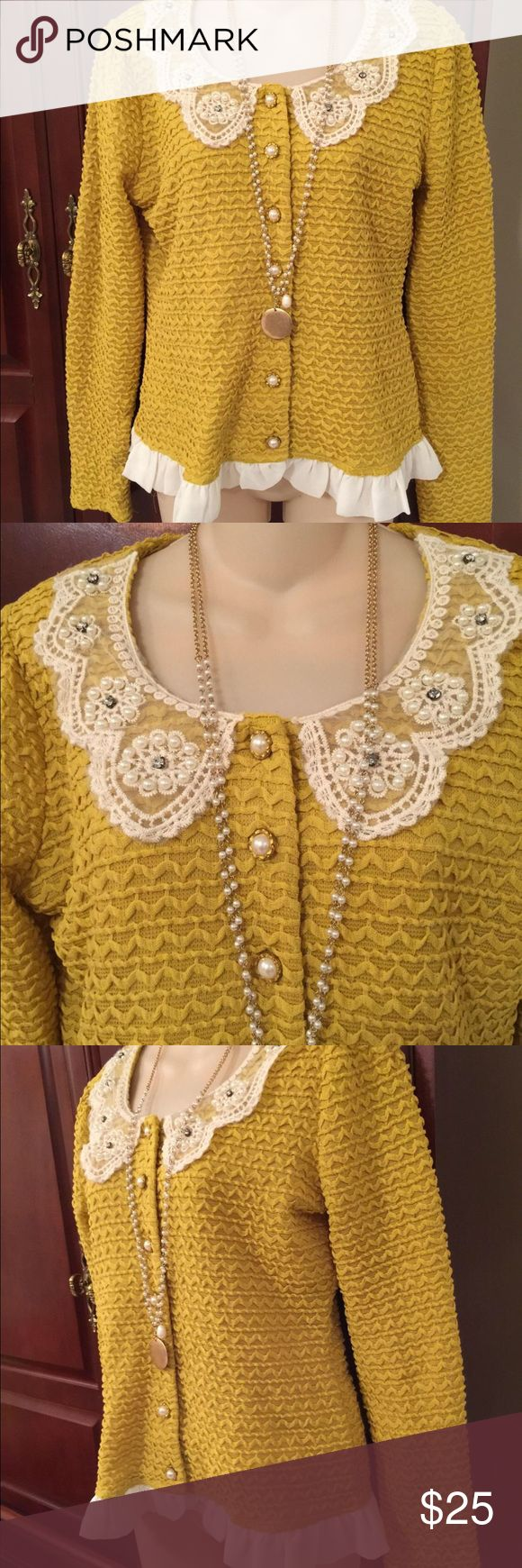 Gorgeous cardigan sweater size large beautiful gold cardigan with lace and Pearl accents. So pretty!  Would look great with jeans and boots. It's in like new condition. It comes from a pet and smoke free home. Necklace not included. Areve Sweaters Cardigans