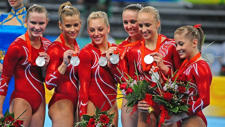 The U.S. women's gymnastics team (Bridget Sloan, Alicia Sacramone, Samantha Peszek, Chellsie Memmel, Nastia Liukin and Shawn Johnson) win a team silver medal at the 2008 Beijing Olympics