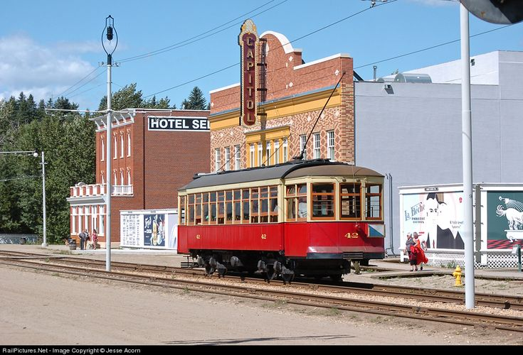 The Edmonton Radial Railway Society runs a streetcar service in Fort Edmonton along with the steam engine run by the Fort Edmonton Historical Association. Here's their usual streetcar #42 posing in front of some nice buildings.