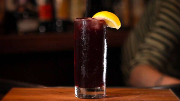 """New York Times Touts Kalimotxo, the """"Poor man's Sangria."""" In a glass filled with ice, combine 3 or 4 ounces dry red wine (preferably Spanish) with an equal amount of cola and 1 squeeze lemon juice. Garnish with a lemon or orange slice to serve."""