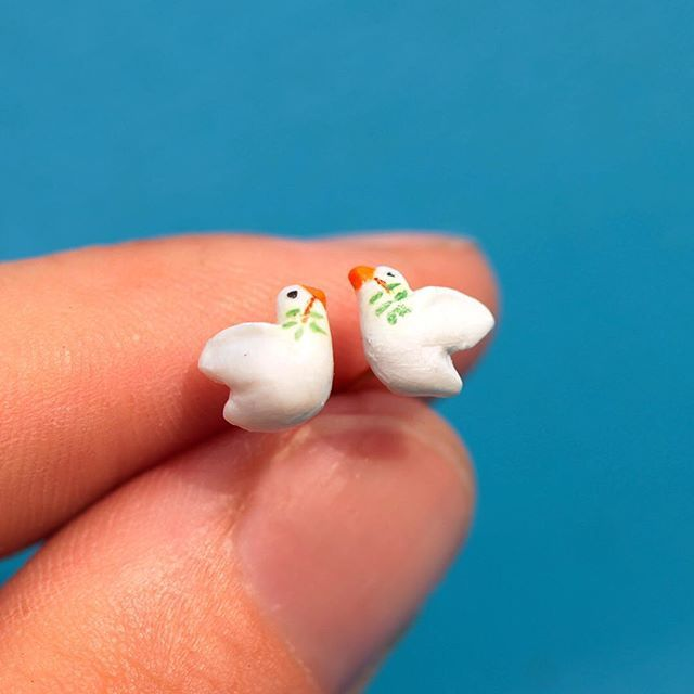 Setting free little peace doves. Send peace to the world! (By wearing these polymer clay earrings).