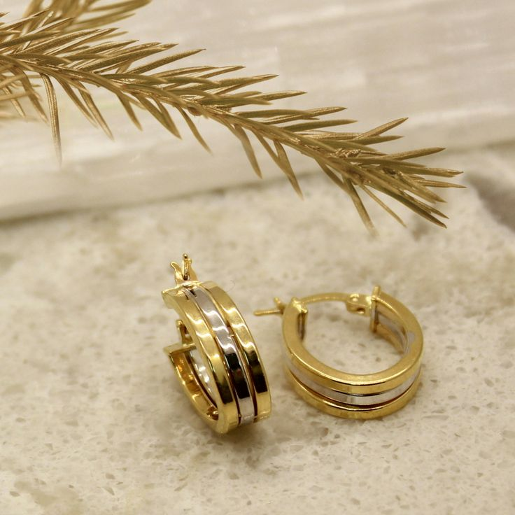 Hoop earrings in gold and white gold. A perfect Christmas gift from Wong Ken's Jewellery.  #earrings #gold #whitegold