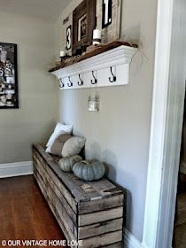 Inspiration pic - shoe box storage bench shown made with old pallets - I would use stock crates from JoAnnes with plastic bins to hold dirty shoes.  The coat shelf above it shown made with crown molding would be replaced with my door knob coat holders and a 1x8.  Add shelf or two above...  Voila!!  Entry way!