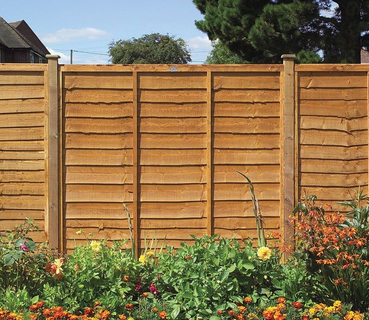 Horizontal slatted fence, built using Siberian Larch. See