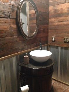 Remodel, rustic bathroom with pallet wall and corrugated tin.