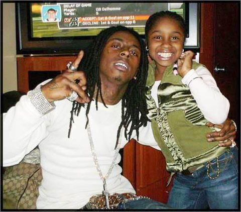 Lil Wayne  And his daughter. Bless.
