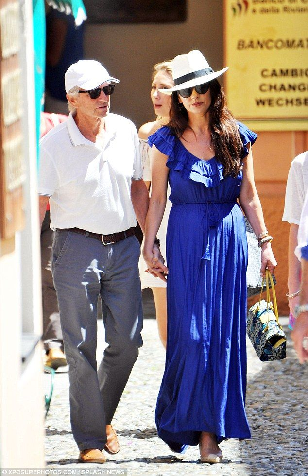 Power couple: Catherine Zeta-Jones, 46, looked every inch the A-list star she enjoyed a da...