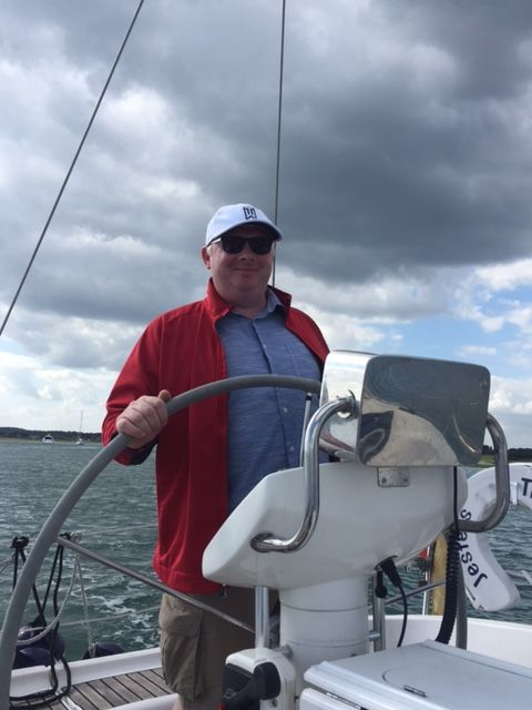 Our Head of Marine, John Hadley, living the dream and taking to the waves at Cowes