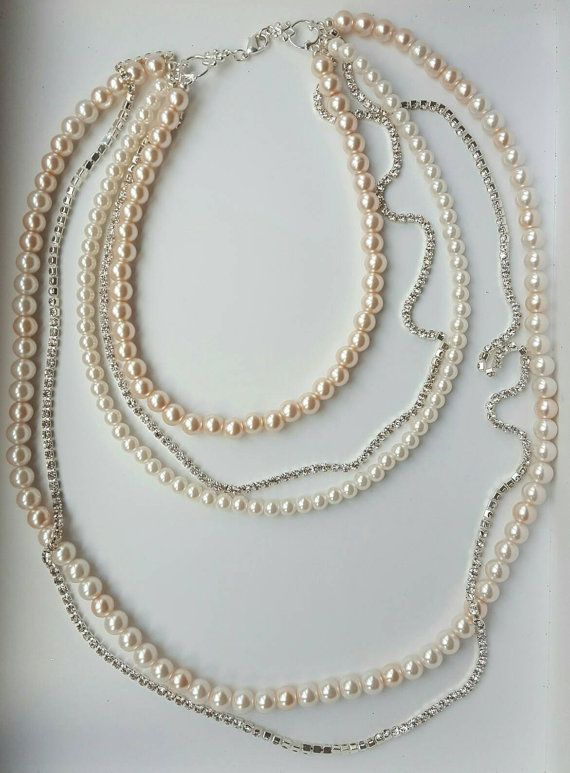 Check out this item in my Etsy shop https://www.etsy.com/ca/listing/497356367/three-strand-pale-pink-pearl