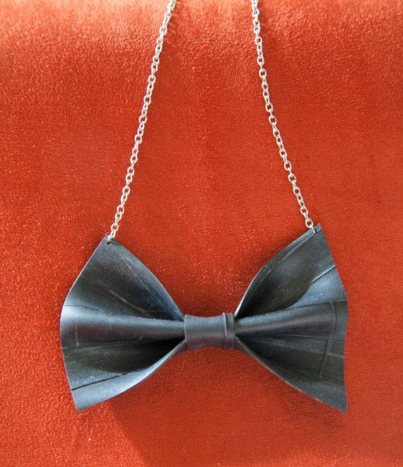 "This bow is handmade from clean recycled bicycle inner tube.  The bow is 3.5"" across The chain is 7"" long on each side  Check out the slightly smaller version: https://www.etsy.com/listing/168983688/bike-tube-bow-necklace"