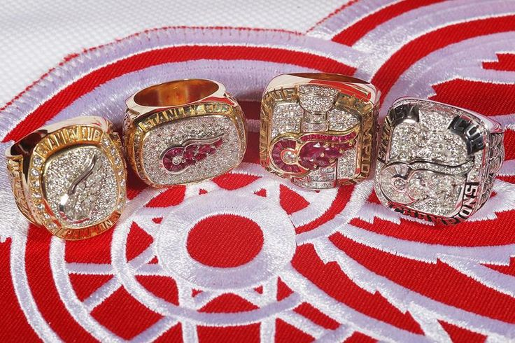 Detroit Red Wings Stanley Cup Championship Rings - 1997, 1998, 2002, 2008. I wish 1995 and 2009 were sitting there too.