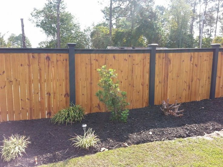Wood Fence With Black Top And Black Posts Elite Fencing In