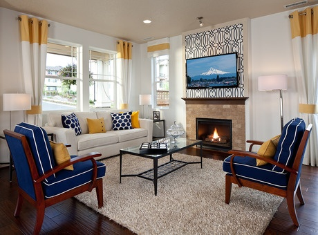 Bright blue and yellow accents in the living room of Residence 4 by Polygon Northwest. The Maple Leaf at Timberland community. Portland, OR.