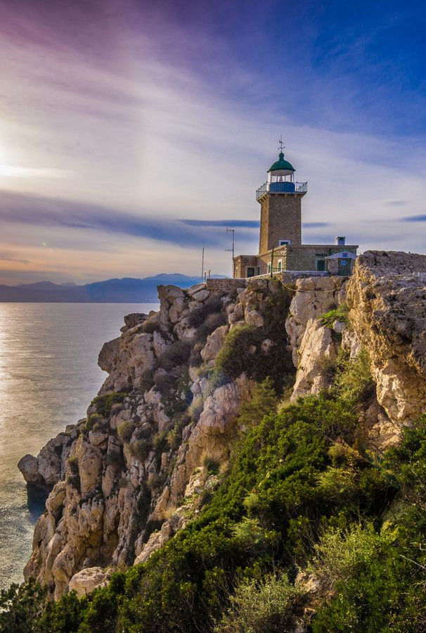 Melagavi lighthouse, located at Loutraki, Greece keeping ships away from the dangerous rocks. by george back on 500px