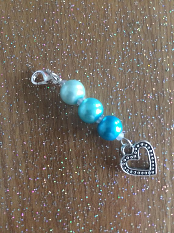 This unique keyring charm has been crafted to add a touch of colour and beauty to your keys or bag.  - Approximately 5.5cm long - Attaches by a 10mm lobster clasp  It is also perfect to give as a beautiful gift to your best friend, a partner or a family member. Would do well for birthdays, celebrations and as a stocking filler.