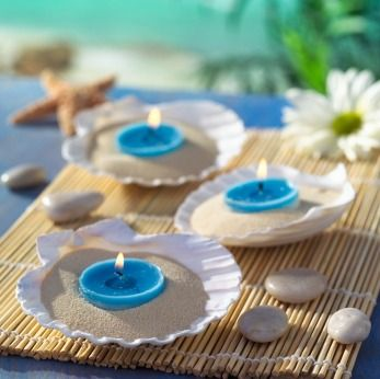 medium sized seashell dishes, fill them up with sand and anchor a colorful tea light candle within the sand. You can make this even more festive by placing two or three of them on top of a bamboo placemat and scattering a few rocks, starfish and flower petals around.