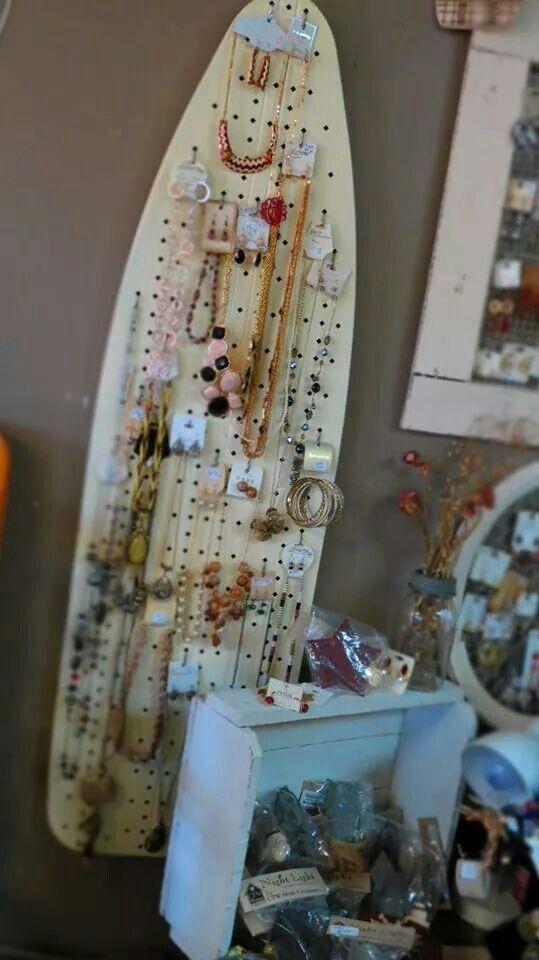 Vintage metal ironing board repurposed to jewelry display.
