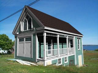 cute little blue cottage by the sea