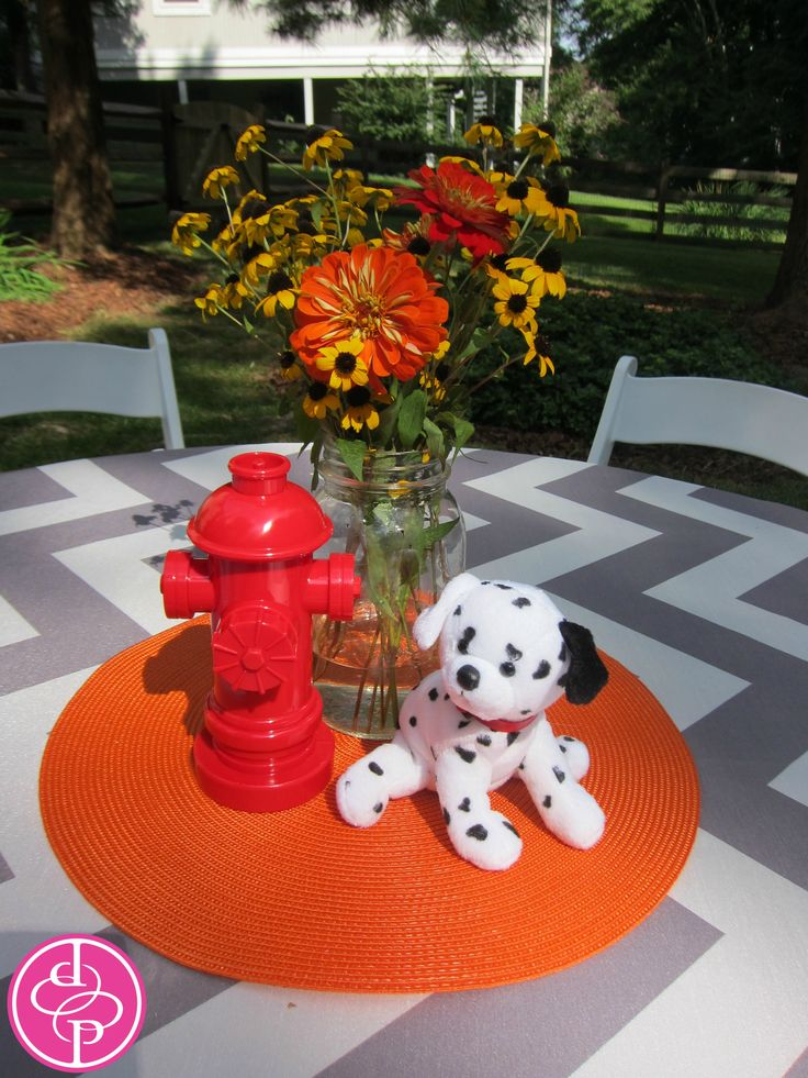 Table centerpiece with dalmation dog fire hydrant toy